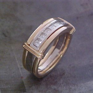 gold and diamond wedding band side view