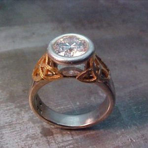 celtic custom ring with round diamond in bezel setting