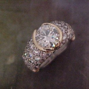 custom ring with diamond encrusted band and large round center diamond