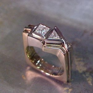 custom ring with white gold band and square and triangle center diamonds side view