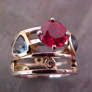 custom gold ring with rubies and sapphires