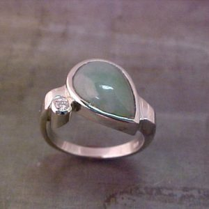 custom ring with teardrop center stone