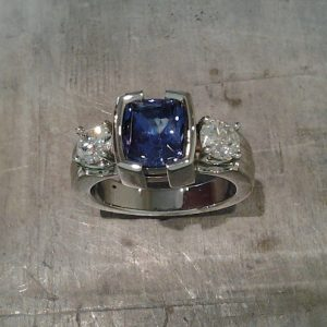 white gold with diamonds and large sapphire in square setting top view