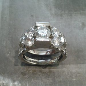 custom designed ring with many large diamonds