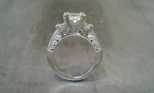 custom three stone engagement ring with 14k white gold and diamond accent band