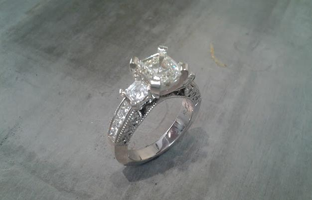custom three stone engagement ring with 14k white gold and diamond accent band top view