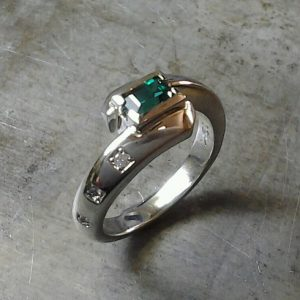 custom ring with square emerald center stone