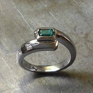 custom ring with square emerald center stone top view