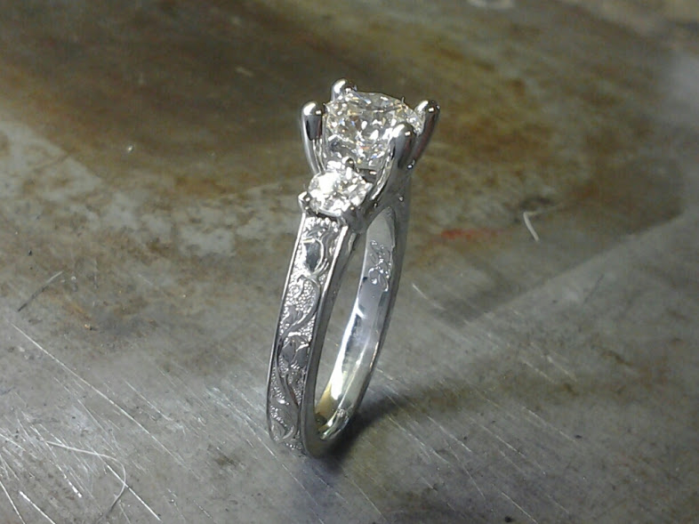 3 stone engagement ring with hand engraved roses