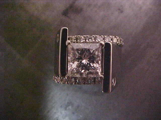 princess diamond offset engagement ring