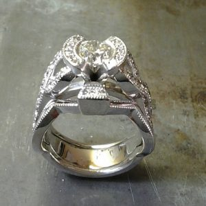 open bezel engagement ring