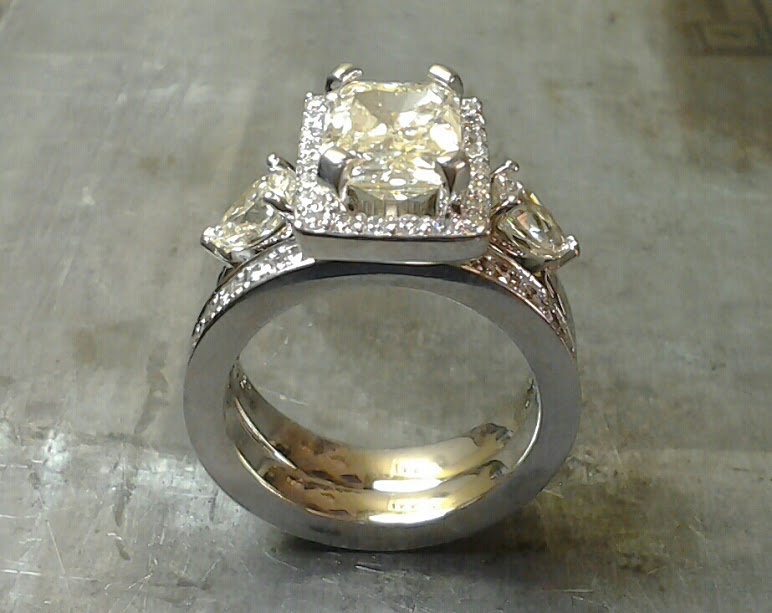 19k Custom Radiant cut, pear shape, rectangle halo, eternity band re-make.