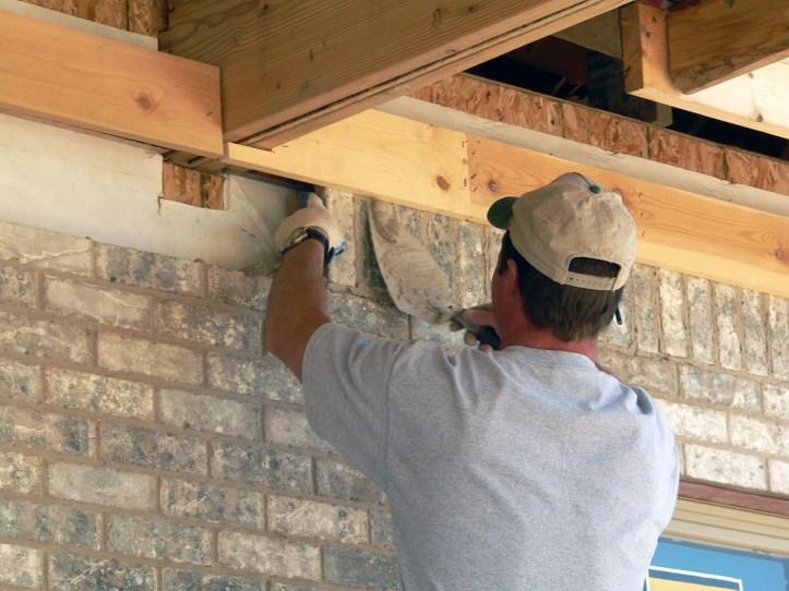 mason lays brick