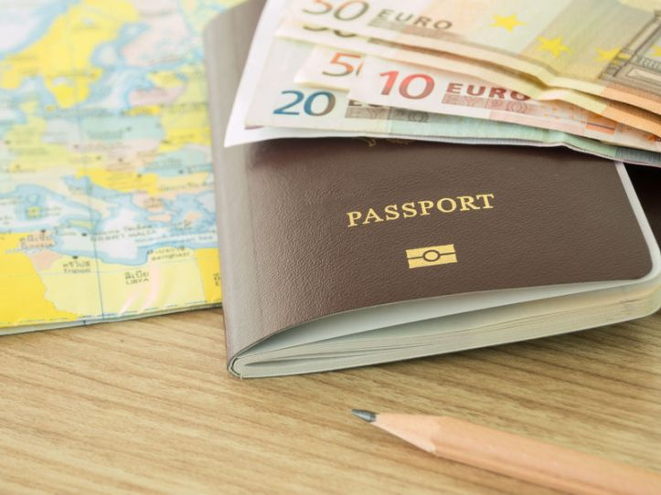 46989188 - closeup passport on world map with banknote