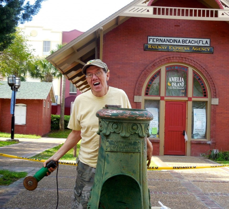 Local preservationist Chuck Hall removes decades of rust from the Duryee Fountain in front of the Train Depot.