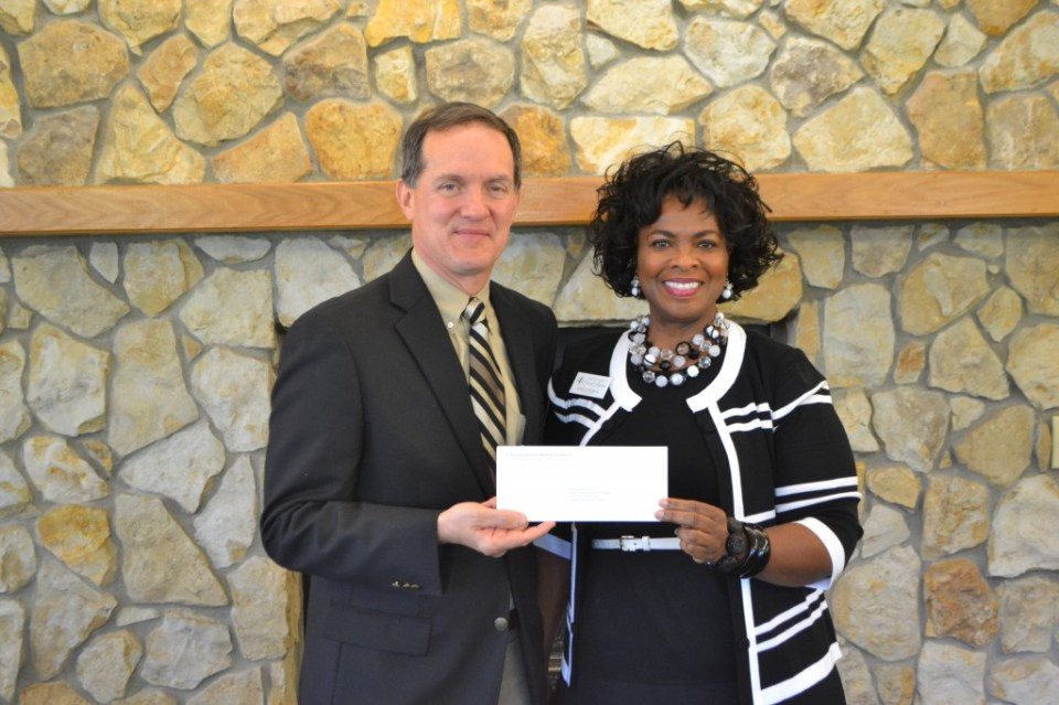 Rayonier Advanced Materials Fernandina Plant General Manager C.A. McDonald presents a grant to Janice Ancrum of the Nassau County Council on Aging.