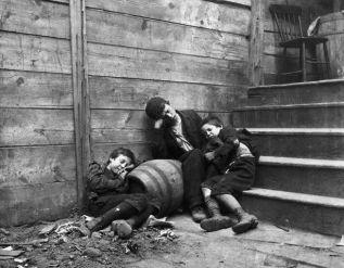 Three Children Sleeping in a Dirty Alley