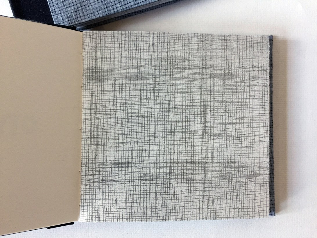 "Interior page of artist book by Wendy Fernstrum titled ""1/1"" showing artwork that looks like a screen or netting"