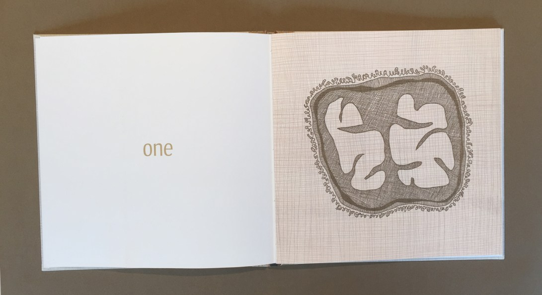 "Opened book showing ""one"" as text on the left and a drawing of an abstract object"