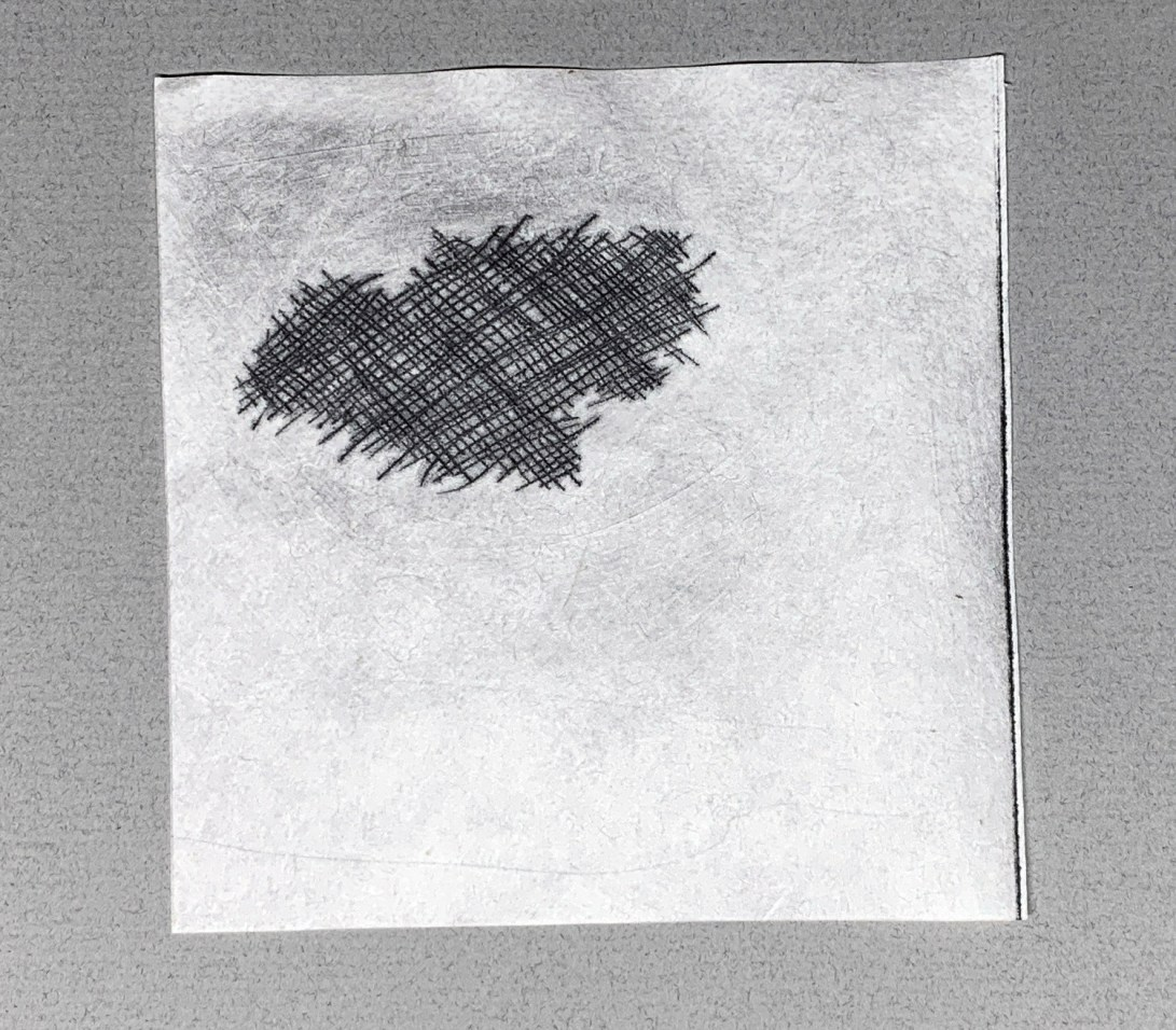 image of a torn piece of cloth printed on paper