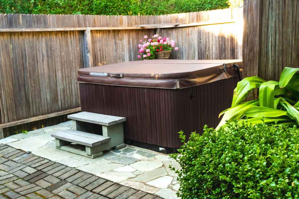 cottage patio with hot tub