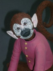 "Red Weldon Sandlin, ""The Hurtea Gurdy Tales: A Nickel for the Monkey"" 2006, detail, ceramic, wood, acrylic paint, 16.5 x 11.5 x 11""."