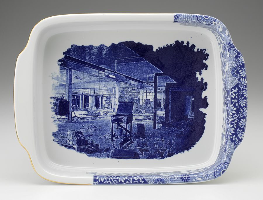"Paul Scott, ""Cumbrian Blue(s) - Spode Works Closed"" 2009-2011, in-glaze decal, gold lustre on Spode Italian casserole salvaged from the kiln area in the closed Spode factory, 15 x 11 x 2.25"". Museum of Fine Art, Boston Collection."