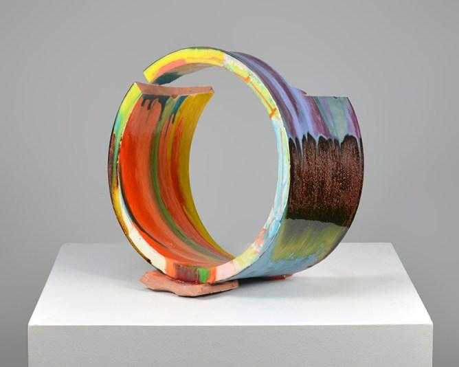 """Lauren Mabry, """"Spilling Fragment (Orange Spill)"""" 2016, red earthenware, slips, glaze, 16 x 15.5 x 11.5""""."""