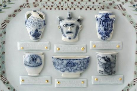 "Mara Superior, ""Americana: A Collection of Blue Salt-glazed Stoneware"" detail, 2016, porcelain, glaze, gold leaf, 15 x 19 x 2""."