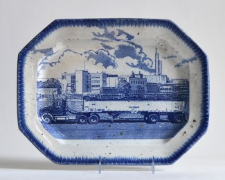 "Paul Scott, ""Scott's Cumbrian Blue(s), American Scenery, Residual Waste No: 1,"" 2015, glaze, decal, c. 1840 pearlware platter, 10 x 13.5 x 1""."