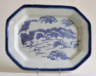 """Paul Scott, """"Scott's Cumbrian Blue(s), Clouds No. 2 after Cadre and Lisa,"""" 2015, glaze, decal, gold, on c. 1840 feather-edge pearlware platter, 11.25 x 14.75 x 1.25""""."""