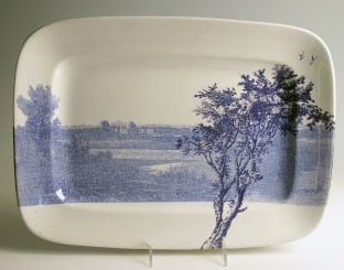 "Paul Scott, ""Cumbrian Blue(s), American Scenery, Hudson River, Indian Point No. 2"" 2013, inglaze decal collage, gold luster on KT&K S--V China (Knowles Taylor and Knowles, Liverpool, Ohio) platter, c. 1920, 7 x 10""."