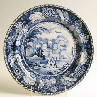 "Paul Scott, ""Cumbrian Blue(s), Scenery, Oriental, Mahomedan Mosque"" 2013, inglaze decal collage, gold luster on transferware plate (manufacture unknown) c. 1820, 9.75 x .75""."