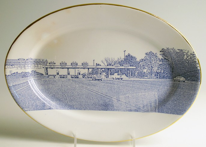 "Paul Scott, ""Cumbrian Blue(s), American Scenery, Toll New Jersey Tpke"" 2013, inglaze decal collage, gold luster, on Richard Alcock Ironstone platter c. 1875, 8.75 x 12.25""."