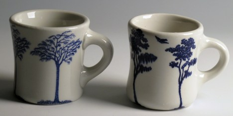 """Paul Scott, """"Cumbrian Blue(s) Pittsfield Trees (left), Trees (after Spode) (right)"""" 2013, inglaze decal collage on Restaurant Ware, ~3.5""""."""