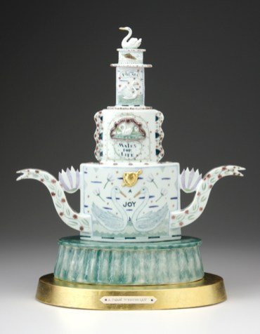 "Mara Superior, ""Mates for Life (A Swan's Wedding Day)"" 2008, high-fired porcelain, wood, gold leaf, bone, ink, 23 x 16 x 10""."