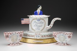"Mara Superior, ""President Obama's Tea Party"" 2012, porcelain, wood, gold leaf, bone, ink, 15 x 25 x 7.5""."