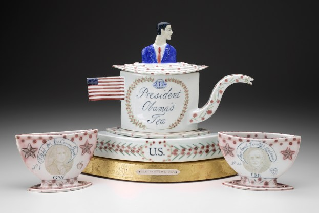 "Mara Superior, ""President Obama's Tea Party"" 2012, porcelain, wood, gold leaf, bone, ink, 15 x 25 x 7.5""."