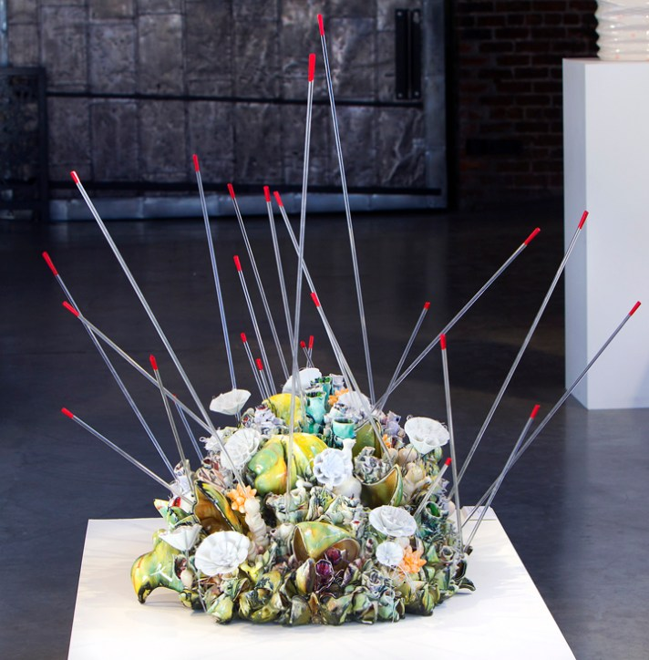 "Susan Beiner, ""Germinating Domes"" 2012, porcelain, acrylic rods, foam, thread, 40 x 46 x 45""."