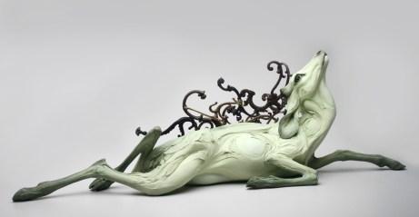 "Beth Cavener, ""Obariyon"" 2013, stoneware, antique hooks, 17 x 46 x 30"" ."