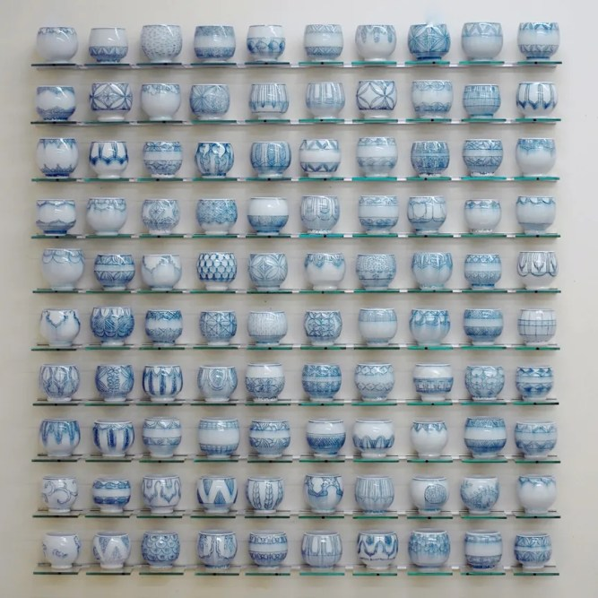 """Steven Young Lee, """"Blue Cup Panel"""" 2013, porcelain with cobalt inlay, 46 x 50 x 4""""."""