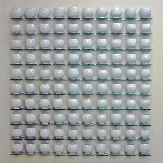 "Steven Young Lee, ""Cup Panels"" (white), 2013, porcelain, white slip, glaze, glass shelving, aluminum, 46 x 50 x 4""."