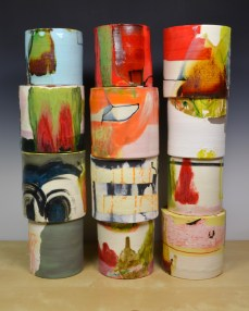 """Lauren Mabry, """"Composition of Enclosed Cylinders"""" 2013, red earthenware, slips, glaze, 20 x l7 x 6""""."""
