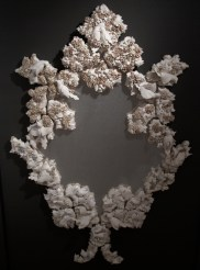 "Kate Roberts, ""The Space Between You and Me"" 2011, colored porcelain, mirror, tulle, 96 x 60 x 6""."