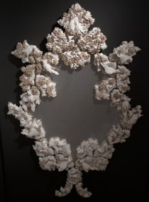 """Kate Roberts, """"The Space Between You and Me"""" 2011, colored porcelain, mirror, tulle, 96 x 60 x 6""""."""
