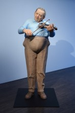 """Tip Toland, """"Long Ago and Far Away"""" 2008, stoneware, paint, pastel, synthetic hair, fiddle, bow, 78 x 31x 30"""". Courtesy of Barry Friedman Ltd."""