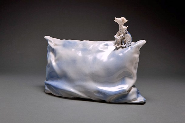 "Coille Hooven, ""Security Pillow"" 1982, porcelain, 10 x 13 x 7""."