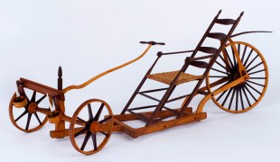 "Roy Superior, ""Shaker Dragster"" 1984, wood, metal, leather, wax, string, 9.75 x 24 x 8.75"". (Allan Stone Collection)"