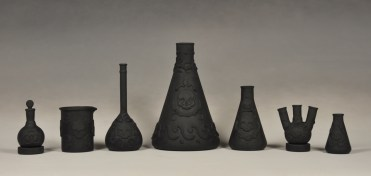 "Daniel Listwan, ""Biohazard Jasperware: Black Basalt Series"" 2013, porcelain, tallest is 13""."