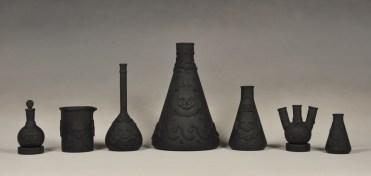 "Daniel Listwan, ""Biohazard Jasperware: Black Basalt Series"" 2013, porcelain, tallest is 13""."